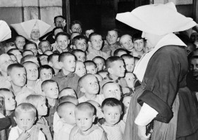 Some-of-Polands-thousands-of-war-orphans-at-the-Catholic-Orphanage-in-Lublin-on-September-11-1946-where-they-are-being-cared-for-by-the-Polish-Red-Cross.-Most-of-the-clothing-as-well-as-vitamins-and-medicines-are-provided-650x462